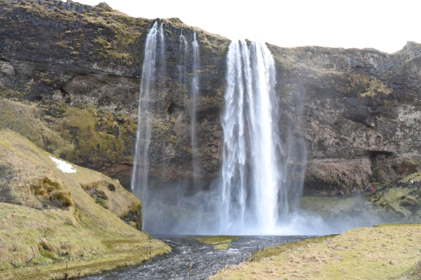 Seljalandsfoss waterfall located in the south region of Iceland. The waterfall drops 60 m (200feet) and is part of the Seljalands River. You can walk behind the fall.